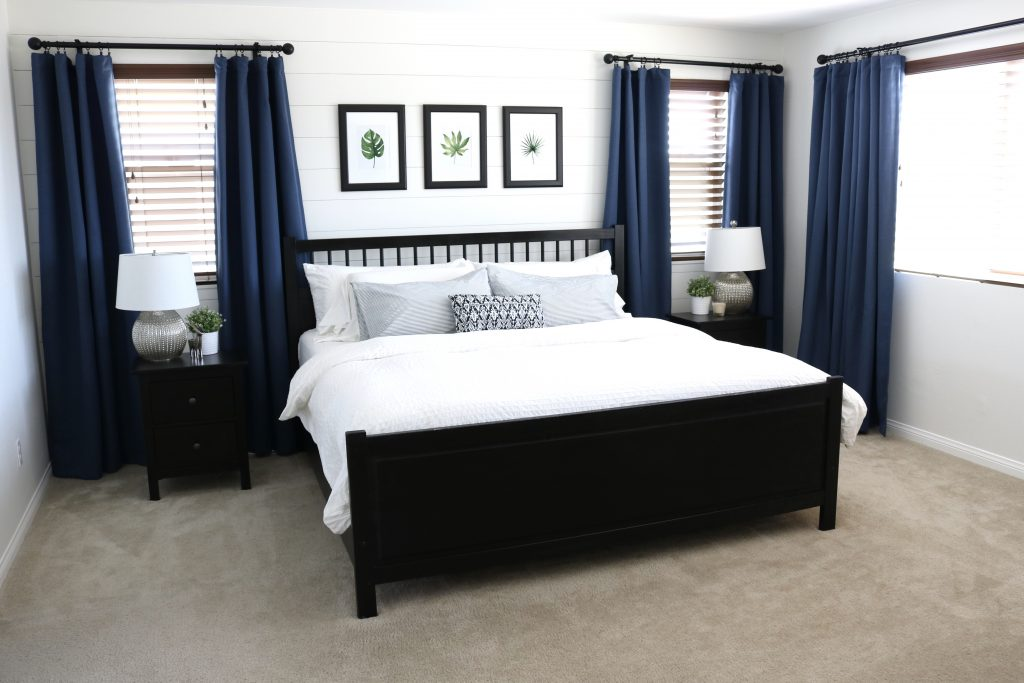 Master bedroom revamp with a shiplap focal wall and new craftsman door trim!